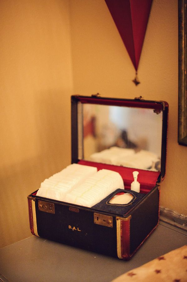 Antique train case to hold diapers and supplies by the changing table