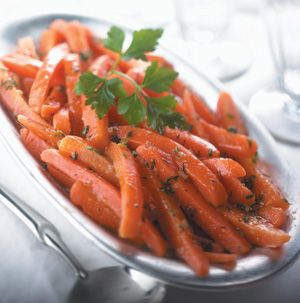 No more plain carrots! Honey-Glazed Carrots are glazed with honey, butter, nutmeg and a dash of salt for a side dish that's totally different - and totally delicious.