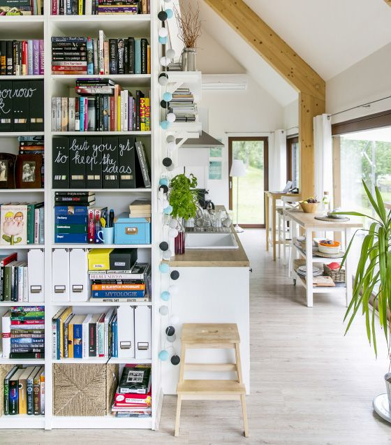 Focus on books: a wall of bookcases holds storage as well