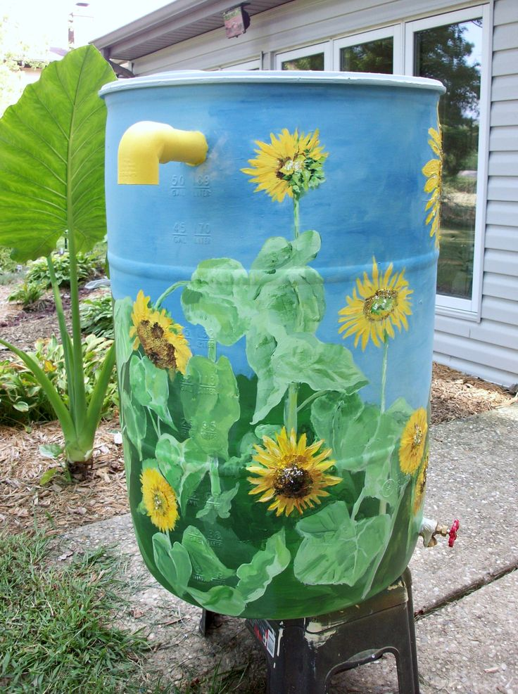 DECORATIVE NATURE-THEMED RAIN BARRELS   BY ANNE MILLIGAN (ARTIST)   270-307-0150 or info@annemilligan.com
