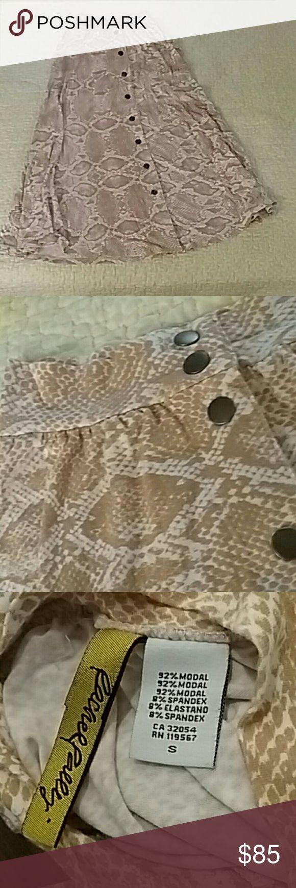 "Rachel Pally snake skin print skirt Lycra like stretchy rayon/spandex woven snap up skirt  just below knee and i am 5'4"" Rachel Pally Skirts"