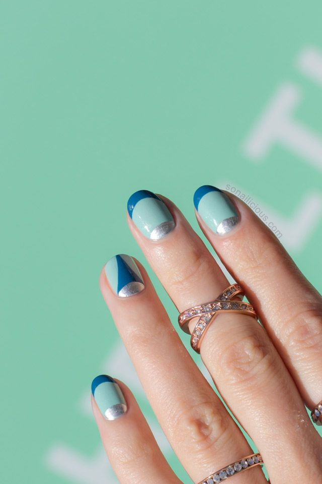 Looking for a twist on your french manicure? This spring, create a double french mani with mint, teal, and silver half moon details.