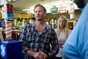 Tara Reid and Ian Ziering in Sharknado (2013)