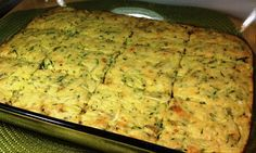 Zucchini Squares.  An oldie but a goodie. Cheesy side dish made with Bisquick heart smart, zucchini,  Parmesan cheese, etc. also good at room temperature.