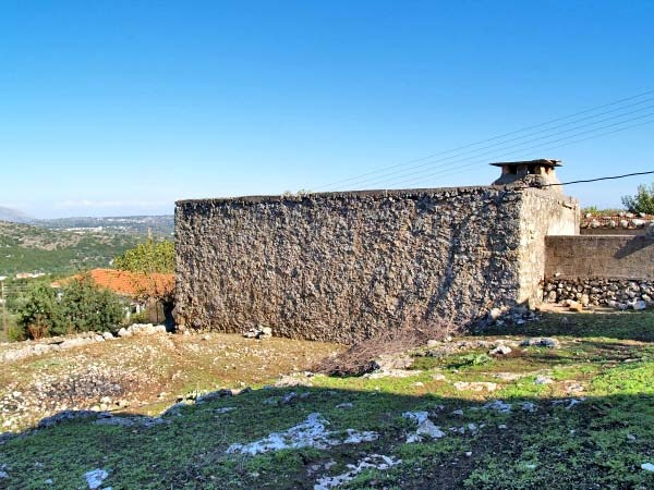 At the outskirts of a friendly and cozy village with stunning views of the Lefka Ori, for sale a village property in need of full renovation on own land of 775m² plus an additional land property of 705,84m² within walking distance...