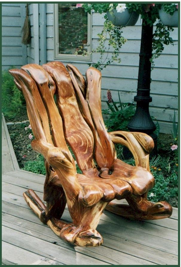 Rocking Chair   Contoured Carving Out Of Tree Trunks To Create Comfortable  Resting Place.