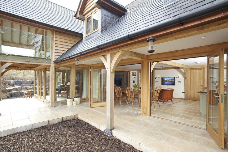 Beautiful kitchen with bi-fold doors. #welshoakframe #oak #home #house #wood #wooden #dream