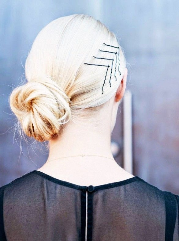 super easy hairstyles - embellished low bun. Spice up your low bun with a couple of well-placed bobby pins—if you have fine hair, spray them with hairspray first to keep them from slipping.