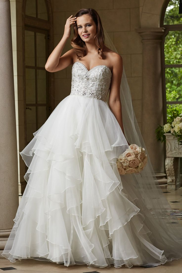 Wtoo Brides Harper Gown LMG: I see you in this type skirt, but with a tulip shape which is fitted at the waist, then flares smoothly into the skirt. Also, for some reason I see a straight across strapless neckline, instead of the cupped style.