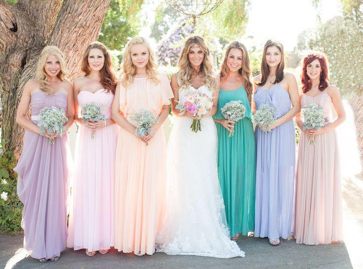 Pretty mix and match pastel bridesmaid dresses {Photo by Shaun and Skyla Walton}