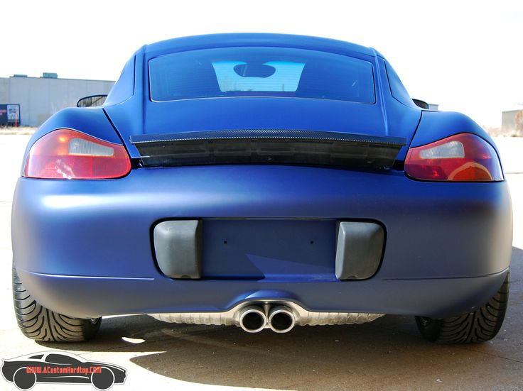 Rear view of a Porsche Boxster with the hardtop installed.