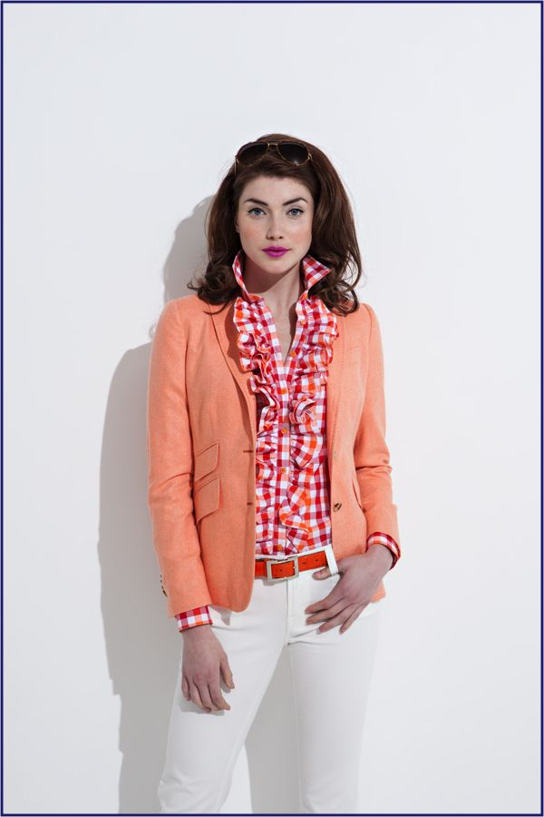Tangerine Blazer, white pants and ruffled shirt. A great use of color!