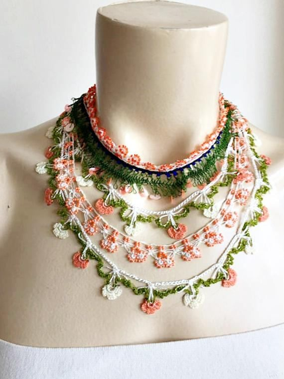 Feminine and stylish This Turkish crochet oya necklace is polyester threads ,sequins and seed beads. This scarf is perfect for ladies as well as tween/teen young ladies as well. Care-Hand wash with soap Measurement- neck line 39 cm 15.5 inc closure with button The scarves are made by me,