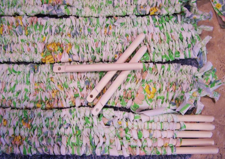 Stick Weaving with fabric for a rug.