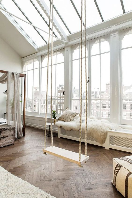 white room with a swing