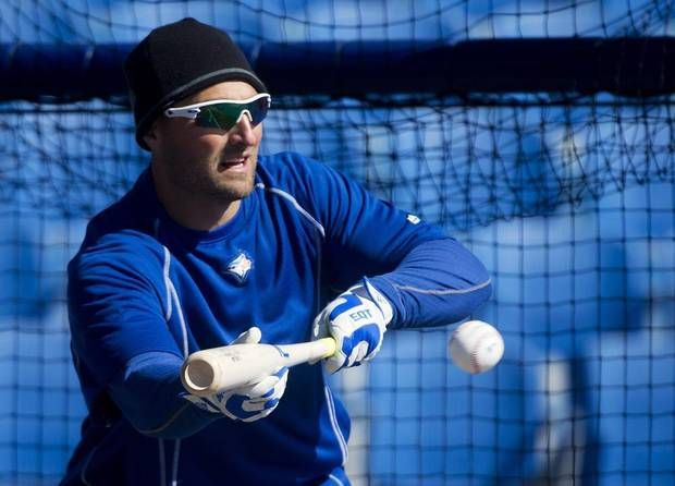 Toronto Blue Jays outfielder Kevin Pillar wears a tuque to stay warm on a chilly day while laying down a bunt during an informal spring training baseball workout in Dunedin, Fla. (Nathan Denette/THE CANADIAN PRESS)