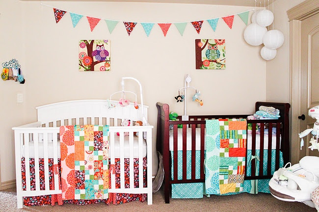 My brightly colored nursery is finally finished! Now just waiting on the babies!!