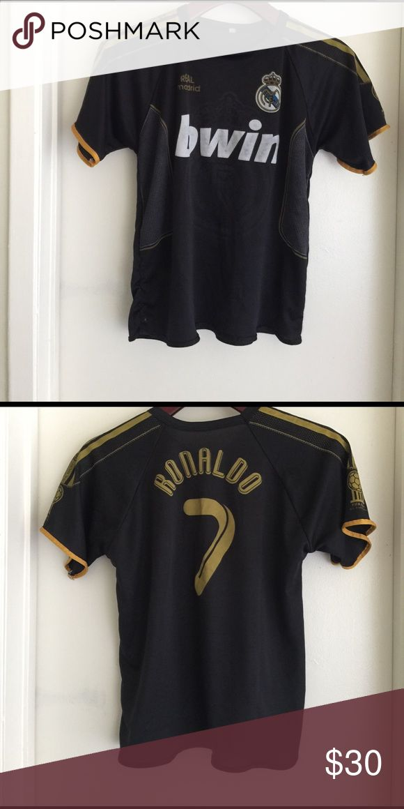 Jersey for boy Real Madrid Size 12 Jersey Real Madrid for boys is Ronaldo number 7 this jersey is for Soccer size 12 original price $90.00 Shirts & Tops