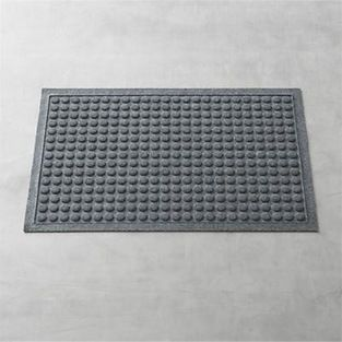 "Thirsty Dots Grey 34""x22"" Doormat - This absorbent ""thirsty"" mat with a fun carved dot design"