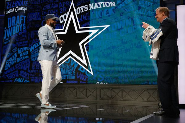 Ezekiel Elliott Photos Photos - Ezekiel Elliott of Ohio State reacts after being picked #4 overall by the Dallas Cowboys during the first round of the 2016 NFL Draft at the Auditorium Theatre of Roosevelt University on April 28, 2016 in Chicago, Illinois. - NFL Draft