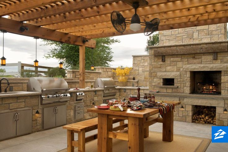 Outdoor entertaining is a breeze on this patio complete with a table, grill, and pizza oven.