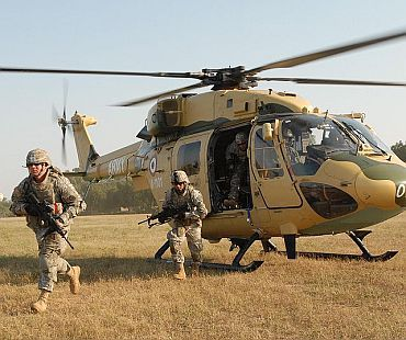 US Army soldiers exit an Indian army HAL Dhruv advanced light helicopter from the 201st Army