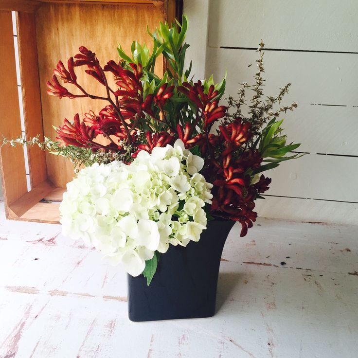 Corporate vase arrangement including hydrangeas, kangaroo paw, leucadendron and tea tree.