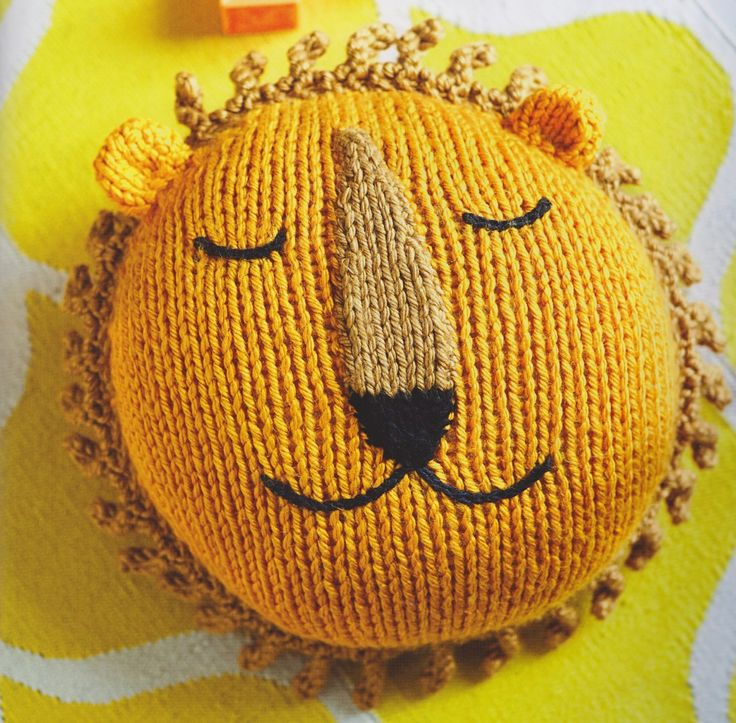 Knitted lion cushion from my book, Knitted Animal Nursery, 2017