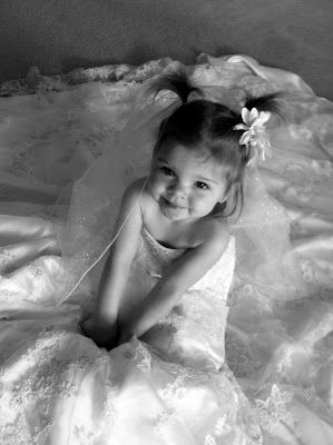 Great idea for home photography of your daughter. Black and white prints of girl in her mother's wedding dress :)