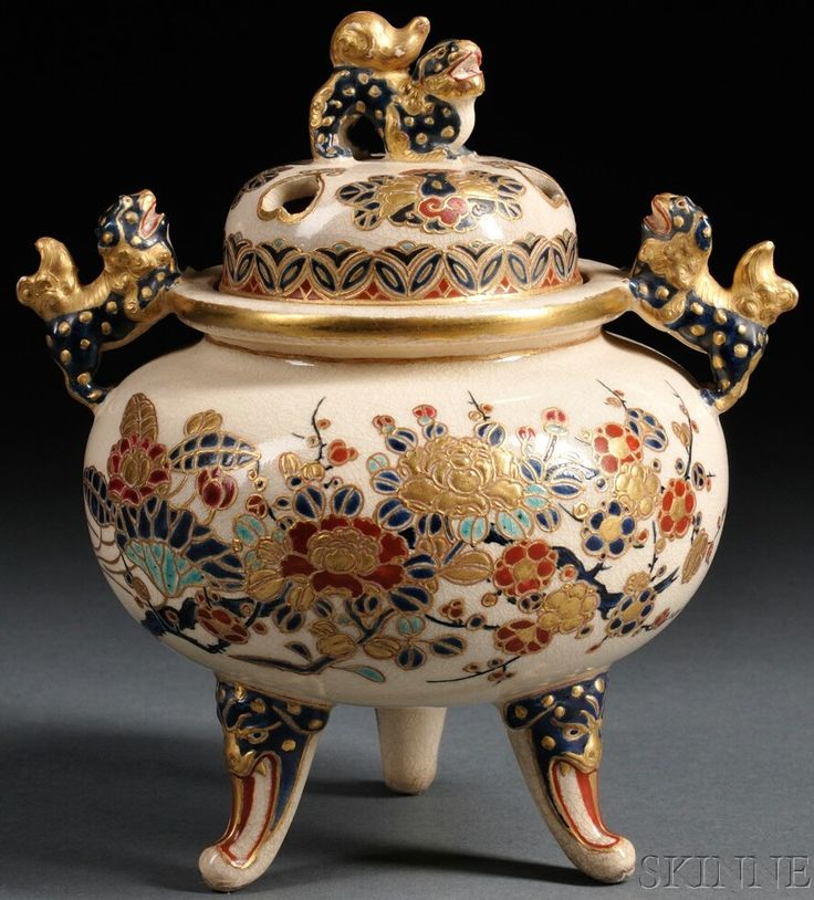 A Satsuma pottery censer, Japan, circa 1801-1900, ovoid shape with tripodfeet, decorated in polychrome enamels and gilt over clear, crackled glaze with flowering branches, the cover finial and liugs od shishi lions