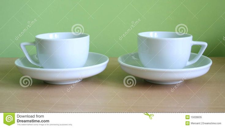 Two coffe-sup with green background