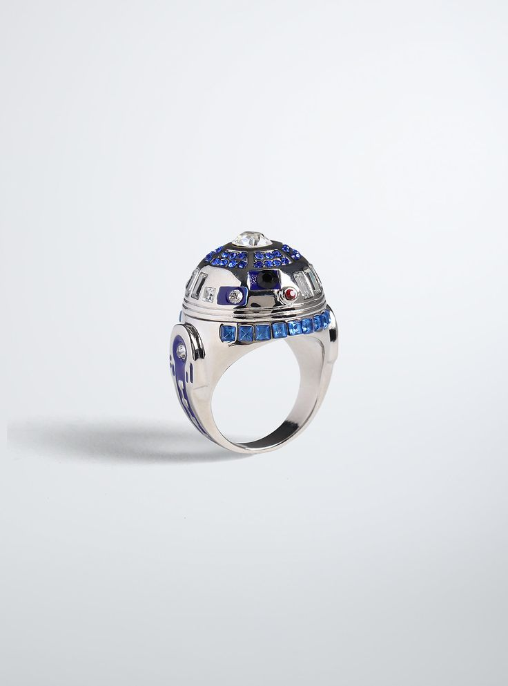 <p>An extremely well put-together little droid makes for an extremely awesome ring! Our hearts are going beep boop for this R2D2-shaped ring, the cutest little droid in the galaxy gleaming with blue, red and clear pavé stones.</p>  <ul> <li>Base metals</li> <li>Imported</li> </ul>
