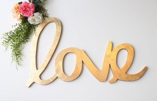 gold leaf cursive love sign