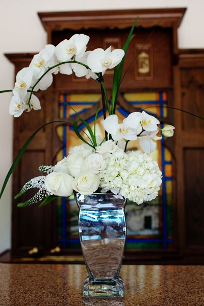 Long stems of phalaenopsis orchids add a modern touch