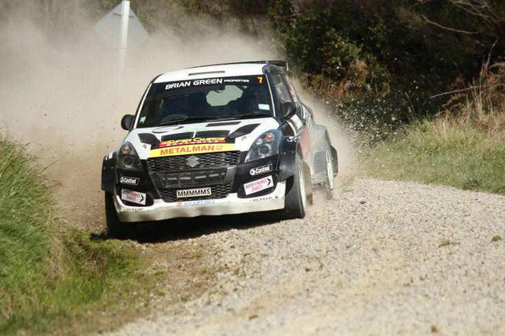 Emma Gilmour's Suzuki Swift Maxi rally car in action