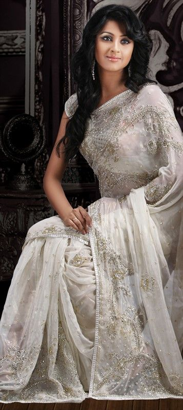 62048:White and Off White color family Saree with matching unstitched blouse.   This is absolutely beautiful.