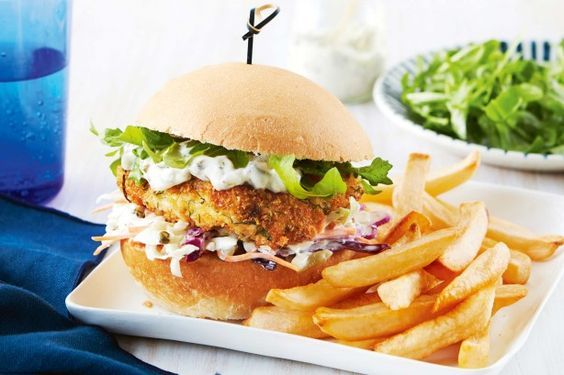 For a meal the whole family will enjoy, try these tasty fish burgers, topped with crunchy coleslaw, rocket and tartare sauce.