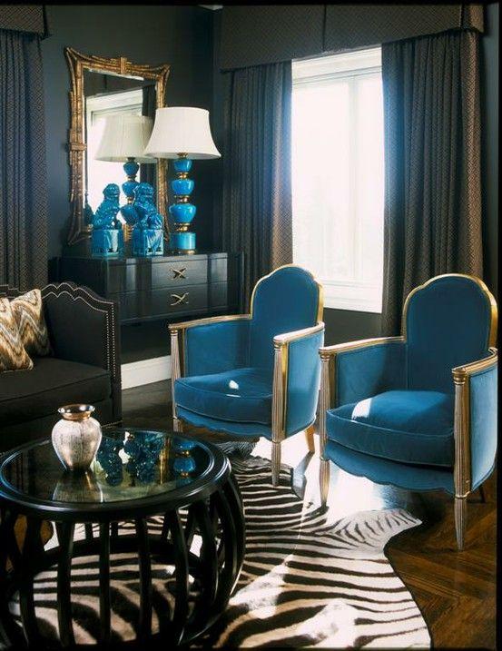 Love the gold accents--design indugences house beautiful blue foo dogs interior design zebra rug nailhead trim black walls