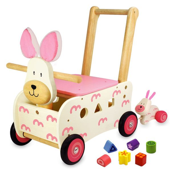 The Walk & Ride Rabbit Sorter features a sturdy rabbit ride on walker with easy grip handle, shape sorting body, shape sorting blocks, handy storage, and a pull-along baby rabbit