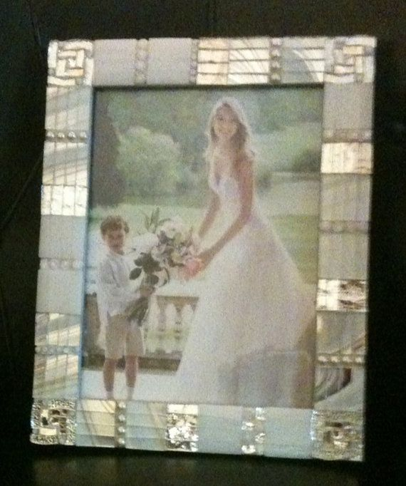 Perfect for a bride. Wonderful mosaico frame with white and silver glasses.Enriched with pearls and Millefiori Murano.