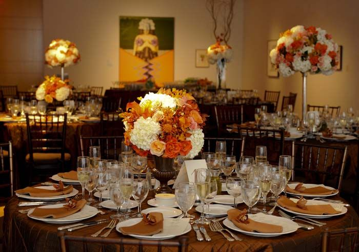 Coral, peach, and brown florals wedding at Philadelphia Academy of Fine Art including low centerpieces in chocolate brown garden urns with Roses, Pincushion Protia, Hypericum Berry, Chocolate Cymbidium Orchids, Hydrangea, and Mango Mini Calla Lilies. {Design: TableArt | Photo: Susan Beard Design}