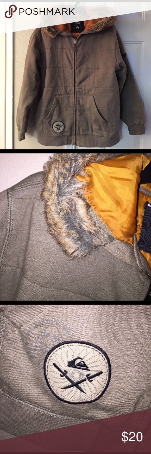 Quicksilver fur hooded coat Sz L juniors Quicksilver fur hooded coat Sz L juniors  - army green tan fur rust lining.  Good condition - small pilling under arms at wrists.  Price reflects pilling quicksilver Jackets & Coats Utility Jackets