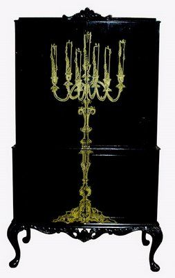 """The """"Darker Side of Bohemian Chic"""" starts with black painted case pieces adorned with haunting chandeliers. #homedecorfashion"""