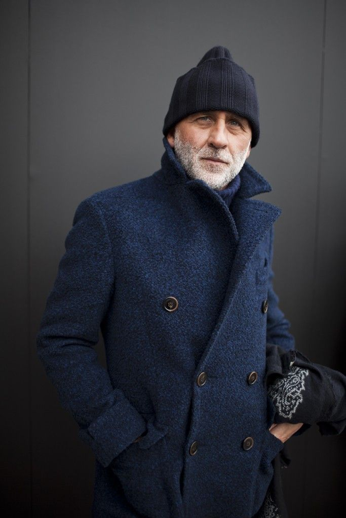 Shop this look for $270:  http://lookastic.com/men/looks/navy-pea-coat-and-black-beanie-and-navy-wool-turtleneck/1070  — Navy Pea Coat  — Black Beanie  — Navy Wool Turtleneck