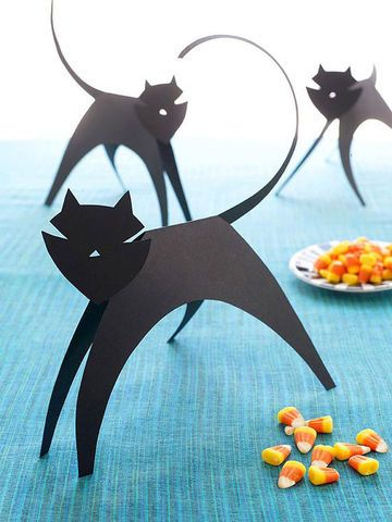 Our sleek family of construction paper cats is the purr-fect project for little Halloween crafters.                 1. Print out our cat template then trace it onto a sheet of black construction paper.  2. Cut out the pieces and assemble the cat with a glue stick according to the template directions.