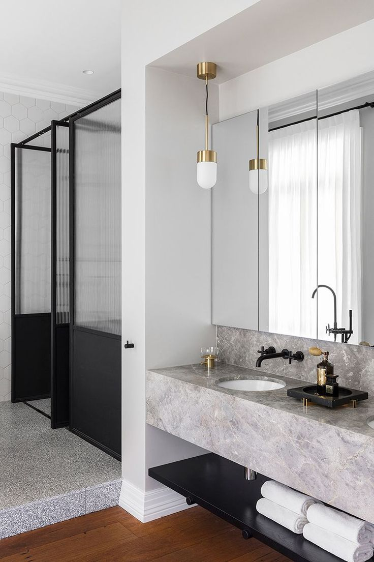 Bathroom materials:  Marble, Terrazzo, Black Hardware and Brass via In/Out: Barcom Terrace by Arent&Pyke