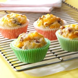 On-the-Go Breakfast Muffins Recipe- Recipes My muffins are a frequent request from everyone in the family. I usually make them on Sunday nights, so when we're running late on weekday mornings, the kids can grab these to eat on the bus. —Irene Wayman, Grantsville, Utah