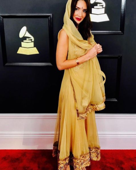 Megan Pormer glows on the Grammy red carpet, accentuating her gown with hair styled by Karo Kangas using Number 4 Hair Care