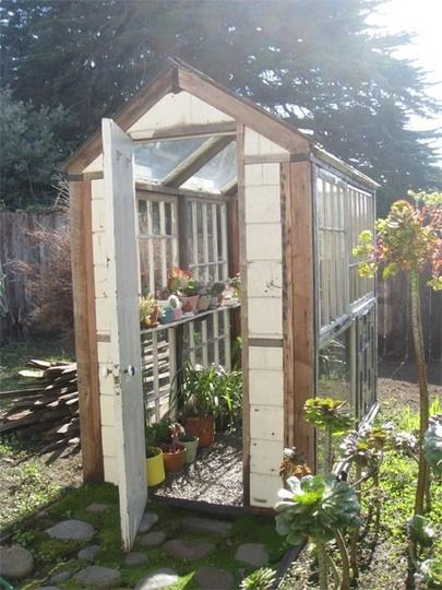 Someday we will have a greenhouse like this.  Then Brendon can garden to his hearts content and then I won't have to clean all the dirt that the kids spill onto the floor.