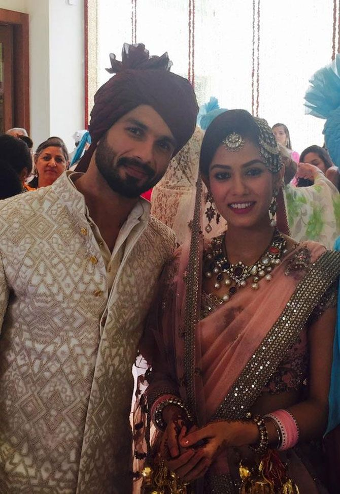 Shahid Kapoor, Mira Rajput #JustMarried Pics: Mira's in a delicate rose-hued Anamika Khanna lehenga with just the right amount of shimmer & shine that complimented Shahid's cream-white Sherwani suit. She sported an elaborate Navratna neckpiece & earrings set, & teamed her look w/ a 'maang-tikka', 'jhoomar' & head ornaments on low-bun hairdo. via @mubinarattonsey (July, 2015)